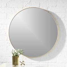 """Free Shipping.  Shop infinity 24"""" round brass wall mirror.   Mirror image without bounds framed thin, trim and exact in pure extruded aluminum with a brushed brass finish.  Handmade frame resists corrosion so it's perfect in the bath."""