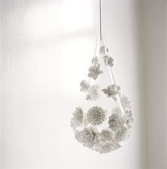 I thought these were made from paper - but NO! It's bone china fused onto a glass bulb-shaped shade. So beautiful, I don't even want to ask how much...