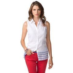 Beautifully feminine with a nautical touch, this sleeveless linen shirt stands out with broad stripes and anchor embroidery above the bottom hem. Accent tape inside the collar. Straight bottom hem. Our model is 1.76m and is wearing a size S Tommy Hilfiger shirt.