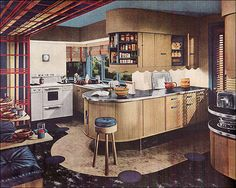 This is a deluxe kitchen obviously, and has some pretty cool design features, especially the tambour doors on the cabinet. This is another Armstrong ad that was published in Ladies Home Journal.