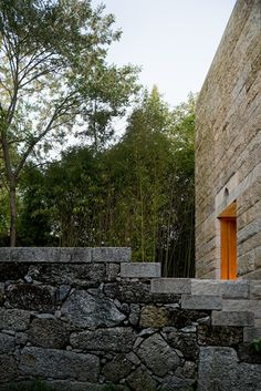 Image 43 of 57 from gallery of St. Ovídio Chapel By Álvaro Siza Through The Lens Of Fernando Guerra. Photograph by Fernando Guerra Information Center, Tourist Information, Stone City, Concrete Bench, Stone Cladding, Painting Concrete, The Gables, Forest House, Wooden Doors