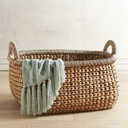 Here's the catch: Magazines, laundry, toys and the like look unsightly if not contained. But throw them in our handcrafted Indonesian basket, and they can sit pretty and be readily accessible. Tightly woven of natural water hyacinth, with sturdy handles and a reinforced rim, the Carson basket makes a naturally neat accent piece.