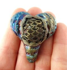 Caged Raku Heart Cabochon Ceramic Jewelry Supply by MAKUstudio - awesome!  (but then all of Mak's stuff is awesome)  :-)