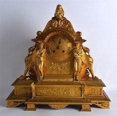 19TH CENTURY FRENCH ORMOLU MANTEL CLOCK of Egyptian Revival inspiration, the… Mantel Clocks, Mantle, Radios, French Clock, Pocket Watches, Egyptian, 19th Century, Masks, Auction