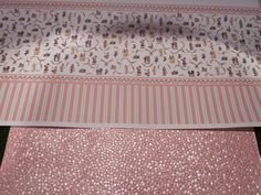 Nov. 1, 2014 - The only place I could find Victorian style nursery wallpaper was the Dollshouse Emporium; fortunately it was pink for baby Mabel.  The solid pink sheet below it is a sheet of scrapbooking paper from Michael's.  I wanted to paper the ceiling with a colored paper; this was the closest match (is not as shiny as it looks here) in terms of color and will make the ceiling look like it was plastered/stippled.