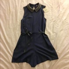 ASOS Navy Romper US Size 2- New with Tags ASOS Navy Romper with Black Leather Peter Pan Collar & Detachable Belt. Keyhole back. US Size 2. Runs true to size. New w/ tags. Great with tights in the winter or sandals in the summer. Listed price or best offer. ASOS Pants Jumpsuits & Rompers