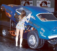 """""""Jungle Jim"""" Funny Car Dragster. Must Be The '70's Judging From The Gal's Go-Go Boots."""