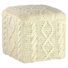 Hand-knit wool ottoman with a traditional Shetland pattern.  Product: OttomanConstruction Material: WoolColor: WhiteFeatures: LightweightDimensions: 18 H x 18 W x 18 D