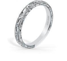 This timeless classic is a ladies' band from the Carmella collection. It features . The signature handcrafted details include scroll hand engravings and milgrain edging.