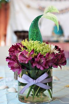 Gorgeous mermaid tail floral centerpiece - just perfect for a Little Mermaid birthday party. So creative!