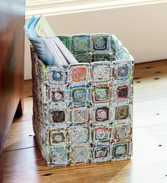 "Recycled Paper Basket Versatile Eco Basket This multi-purpose container is crafted of recycled magazines and newspapers! Artisans in the Philippines create reinforced paper ""threads"" using wire as a base; threads are tightly woven into original patterns that organically produce a folk-art design. Size 9-1/2""H x 11""W"