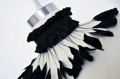 Feather collar. I'm overfond of feather collars, but I'm thinking more along the lines of incorporating leather...