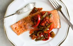 "Oven-steamed arctic char with piperade. This fish recipe uses whole grilled striped bass on the Seafood Watch ""Best Choices"" list."