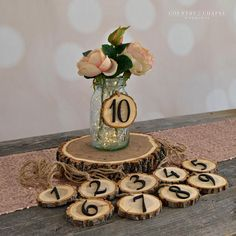 Hanging Tree Slice Table Numbers Aspen is part of Wedding decorations These versatile table numbers can be tied around mason jars, vases, or lanterns, and seamlessly integrated with your wedding ce - Aspen, Floral Wedding, Wedding Colors, Modest Wedding, Pallet Wedding, Tree Slices, Wedding Table Centerpieces, Diy Wedding Table Numbers, Wood Slice Centerpiece