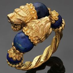 1970s ILIAS LALAOUNIS Blue Sodalite Yellow Gold Chimera Ring | From a unique collection of vintage more rings at https://www.1stdibs.com/jewelry/rings/more-rings/