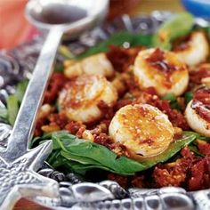 Mediterranean salad with grilled scallops over a bed of fresh spinach tossed in lemon vinaigrette, and topping with a savory mixture of pine nuts and sun-dried tomatoes.