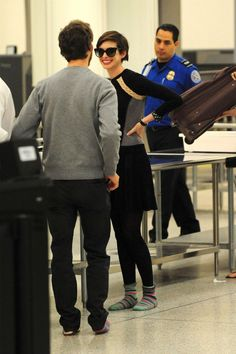 Anne Hathaway with her husband at LAX Airport, March 2013.