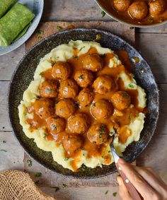 Mashed potatoes with vegan meatballs and gravy. The recipe is plant-based and gluten-free. #vegan #glutenfree #meatballs #gravy #mashedpotatoes   elavegan.com