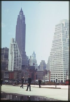 Downtown in 1941 by the great Charles W. Cushman. Almost looks like a men's fashion shoot. Marvelous Art Deco 70 Pine Street and 120 Wall Street.