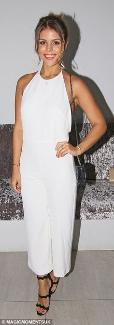 Classic: Chloe Lewis opted for a more understated style in a simple white jumpsuit...