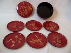 6 Coaster set in a round covered container Japan laquer ware - 8 piece set