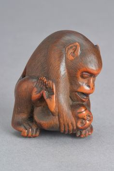 Monkey & young in stained boxwood