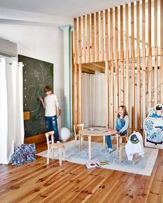 Rustic Wooden Laminate In Flooring Design And Wall Decoration White Wall Paint Curtain Kid Room Round Table Chairs Soft Carpet Whiteboard Sliding Room Dividers, Space Dividers, White Wall Paint, White Walls, Painted Curtains, Round Table And Chairs, Room Divider Curtain, Divider Design, Wooden Screen
