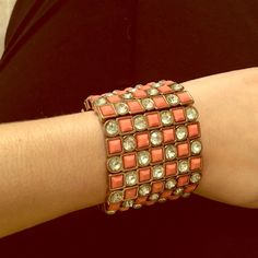 """Gold and coral cuff bracelet! Gold Cuff bracelet with coral and """"diamond"""" beads. This cuff is super durable and good quality. It actually feels pretty heavy (not too heavy where it's annoying) but you can tell it isn't flimsy. Jewelry Bracelets"""
