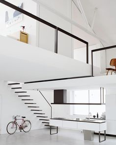 #Loftporn? This former office building is now a clean serene white living space in which black lines provide a minimalist contrast. Owner: Designer Elia Mangia Location: #Milan Italy.  Ricardo Labougle  Find more #home inspiration in 100 INTERIORS AROUND THE WORLD.