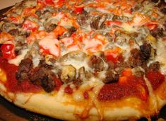 Ground Beef Pizza. Add red bell pepper and Olives. Use Whole wheat pizza crust.