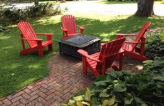 Fireworks red Adirondack chairs around a fire pit
