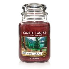 Mountain Lodge - smells of a fire going in a warm mountain lodge.....This is my favorite favorite candle! LOVE!