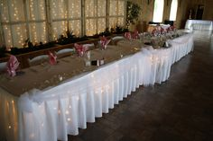 i love this! head table with a sweetheart table in the center! but with rectangular tables at an angle.