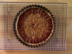BEST PECAN PIE I'VE EVER HAD! I'll definitely be making this pie again. And I'll likely use the recipe to make spiced pecans for snacking too. Bourbon Pecan Pie recipe from Alton Brown via Food Network Healthy Recipes, Pie Recipes, Dessert Recipes, Desserts, Bourbon Recipes, Drink Recipes, Sweet Recipes, Yummy Recipes, Alton Brown