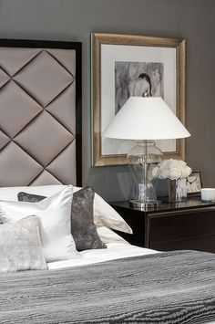 Elegant classic contemporary guest bedroom in luxurious surrey mansion, detail of styling and upholstered diamond padded headboard designed by www.aji.co.uk