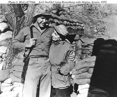 Anna Rosenberg, a former personnel consultant, was the first female Assistant Secretary of Defense. Here she is visiting US troops in Korea in 1951.