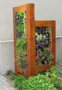 Vertical vegetable gardens are great to use in confined green spaces. You could add worm composting tower inside the structure of this particular vertical garden. This would provide nutrition and health to your plants.