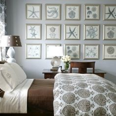 coastal bedroom - love the color palette and the photos to cover a large wall space.