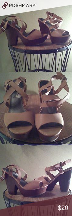 G by Guess sz 8.5M platform sandals Cute pair of platform sandals ,G by Guess. The color I would consider to be nude and the heel is dark brown. They have little wear,but no tears or any visual damage, overall they're in great condition I only wore them about 3 times. Issues are very lightweight, easy to walk in and great if you have a wide foot. Very comfortable and gives you good height. High heel measures 5 inches with a one inch platform in the front. G by Guess Shoes Platforms