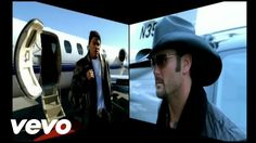 Nelly - Over And Over ft. Tim McGraw....A Hip-Hop/County fusion...groundbreaking stuff...and it works!! :))