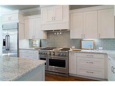 White kitchen // White granite // Grey-blue subway tile