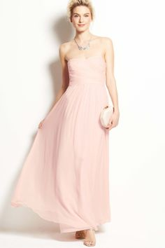 The elegant strapless sweetheart neck blushing pink chiffon floor-length bridesmaid dress with the criss-cross ruches bodice and the natural flowing skirt
