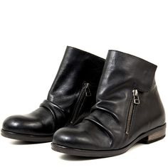 The Hang Out is high-fashion in flat bootie form. Its gathered black leather brings an edge to the overall simple design. The addition of a zipper hardware and closure brings together this classic bootie look, giving it just the high-fashion edge you have been dreaming of.
