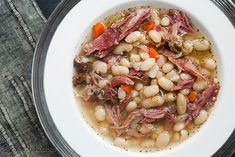 Hearty white bean and ham soup recipe, perfect for cold winter days.  White beans, ham shanks, onions, celery, carrots, garlic, Tabasco, and herbs. ~ SimplyRecipes.com