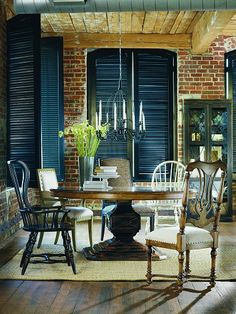 love black shutters, dark wood, and brick combination. Indoor shutters are on my list.