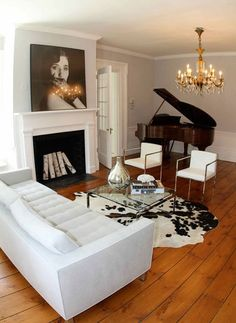 If you're looking for a rug, look no further than a cowhide. Like a little black dress, it can fit into a lot of situations from a casual modern home to a something more traditional or elegant (you can even throw it over a couch!). If you've got pets or small children, it's a good choice; cowhides can take a beating and they clean up easily.