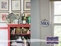 My home office writing shrine and framed book jackets--as taken by Decatur photog Sara Speert.
