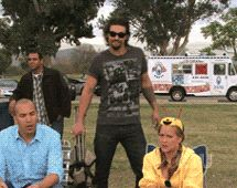 Jason mamoa whips out a folding chair, sits, pleased, listens