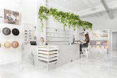 All-White Interior of the Le Manoir Boutique in Montreal by Tuxedo