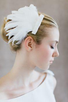 "Bridal Hair Fascinator, Wedding feather hair piece, - ""Ella"". €127.00, via Etsy."